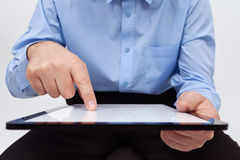 Man working on tablet - closeup on device and hands. With copy space Stock Photo