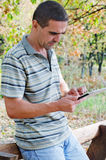 Man working on a tablet in the country Stock Image