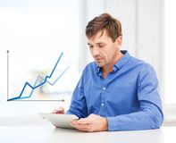 Man working with tablet pc at home Royalty Free Stock Photos