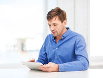 Man working with tablet pc at home Stock Photo