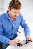Man working with tablet pc at home Royalty Free Stock Photography