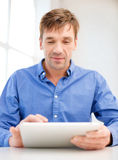 Man working with tablet pc at home Stock Images