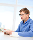 Man working with tablet pc at home Stock Image