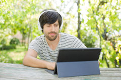 Man working with tablet pc Stock Photo