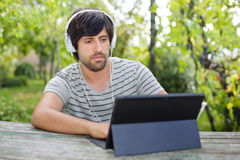 Man working with tablet pc Stock Photos