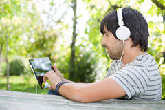 Man working with tablet pc Royalty Free Stock Photo