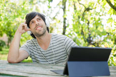 Man working with tablet pc Stock Images