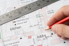 Man working on technical drawing Stock Photography