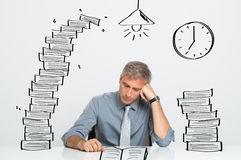 Man working till late royalty free stock image