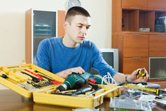 Man  with working tools. Man doing something with working tools in home Stock Photos