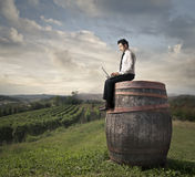 Man working on the top of a giant barrel Stock Images