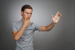 Man working with transparent virtual interface screen. Stock Photos