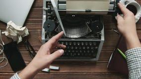 Man working on typewriter. Cropped shot of man pounding typewriter at his workplace stock video