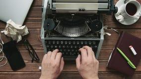 Man working on typewriter stock footage