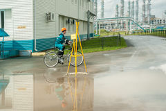 Man in working uniform goes by bicycle Royalty Free Stock Photo
