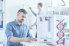 Man working using 3D printer Royalty Free Stock Photo
