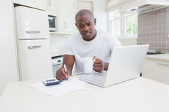 A man working and using his laptop Stock Images