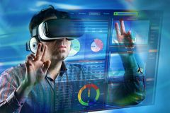 Man working with virtual reality glasses in interface software Royalty Free Stock Photography