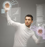 Man working with virtual screens Stock Images