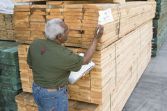 Man Working In The Warehouse. Rear view of a senior male worker working in the warehouse Stock Photography