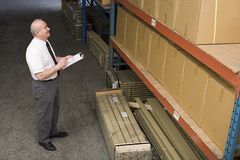Man working in warehouse Stock Photography