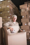 Man working in warehouse. Portrait of a man working in the warehouse Royalty Free Stock Photo