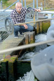 Man working in water treatment plant Royalty Free Stock Images