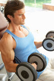 Man Working With Weights Stock Images