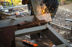 Man working a welding metal Stock Images