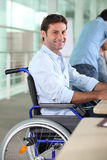 Man working in a wheelchair Royalty Free Stock Photos