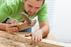 Man working with wood Stock Photos