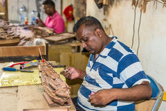 Man Working on Wood Sailing Ship Model. Floreal, Mauritius - December 26, 2015: Man working on wood sailing ship model at the Le Port Ship Models factory in Royalty Free Stock Photos