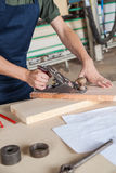 Man working with wood Royalty Free Stock Photography