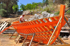 Man working on wooden fishing boat. On greek island samos Stock Photos