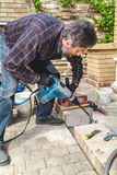 Man working in yard puncher Stock Photography