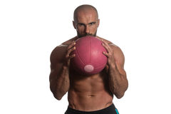 Man Workout With Ball Over White Background Isolated. Muscular Sports Guy With Medicine Ball - Isolated On White Background Royalty Free Stock Photography