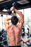 Man workout with dumbbell at gym Stock Photos