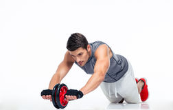 Man workout with fitness wheel on the floor Stock Images