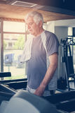 Man workout in gym. Man working exercise on treadmill. Wo Stock Photography