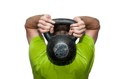 Man workout with kettle bell. Royalty Free Stock Photography