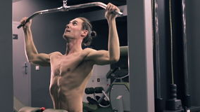 Man Workout With Power Simulator In The Gym stock video footage