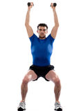 Man workout  weight training crouching Stock Photo