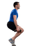 Man workout  weight training crouching Stock Image