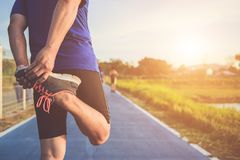 Man workout and wellness concept : Asian runner warm up his body stock photography