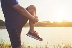 Man workout and wellness concept : Asian runner warm up his body royalty free stock photo