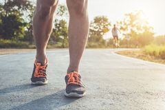 Man workout wellness concept : Runner feet with sneaker shoe run stock photography