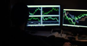 A man works with charts in a dark room