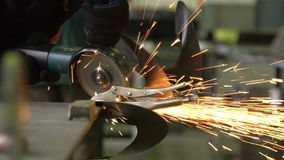 Man works circular saw. Flies of spark from hot metal. stock video