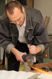 Man works with a circulation saw in studio. Man works with a saw in studio Royalty Free Stock Photos