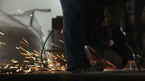 Man Works with Electric Angle Grinder stock footage
